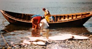 Wooden Opheim dory, fishermen, and halibut